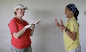 Kathleen Nielson, president, and Wendy Karimoto, 2nd vice president, are painting (or playing) at recent Weinberg work day.